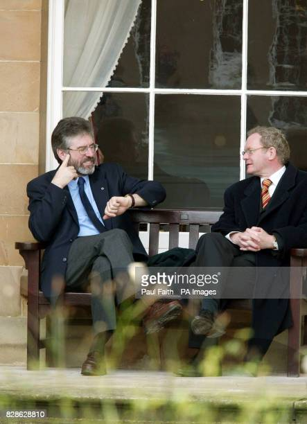 Sinn Fein President Gerry Adams jokes with Martin McGuinness during a break in proceedings at Hillsborough Castle County Down Belfast where the Peace...