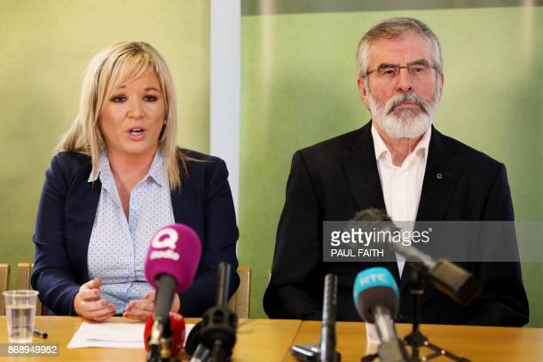 Sinn Fein President Gerry Adams looks on as Northern Leader of Sinn Fein Michelle O'Neill speaks at a press conference at Stormont in Belfast on...