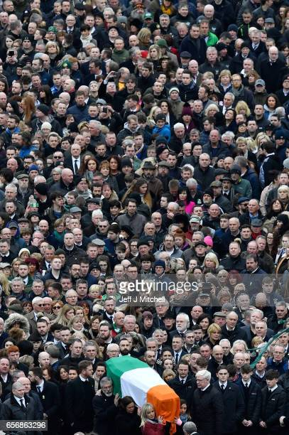 Sinn Fein President Gerry Adams Sinn Fein Southern leader Mary Lou McDonald and Northern Ireland Leader Michelle O'Neill carry the coffin of the late...