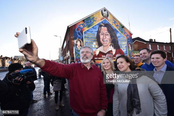 Sinn Fein President Gerry Adams , southern leader Mary Lou McDonald and northern leader Michelle O'Neill take a selfie in front of the Bobby Sands...