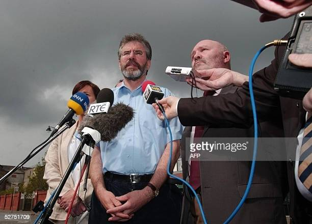 Sinn Fein President Gerry Adams speaks to the media next to party colleague Alex Maskey outside the party's headquarters in Belfast at a final press...