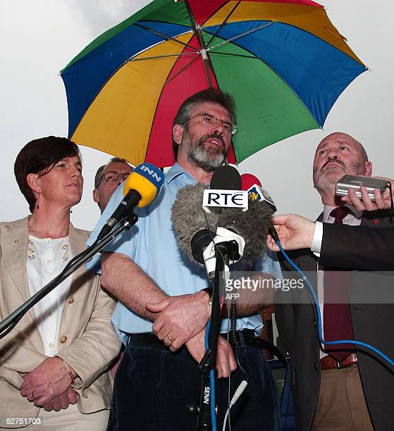 Sinn Fein President Gerry Adams speaks to the media outside the party's headquarters in Belfast at a final press conference prior to Thursday's...