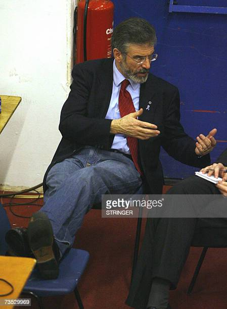 Sinn Fein president Gerry Adams talks to a journalits as he waits for the election's results, 09 March 2007, in Belfast. Adams retained his seats for...