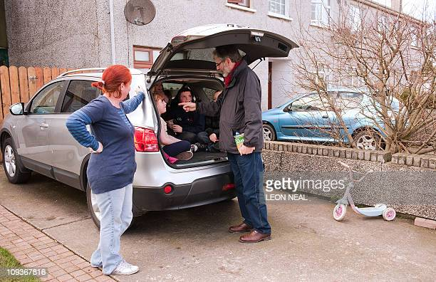 Sinn Fein President Gerry Adams talks with children in a car while campaigning in Dundalk County Louth on February 23 2011 ahead of Ireland's General...