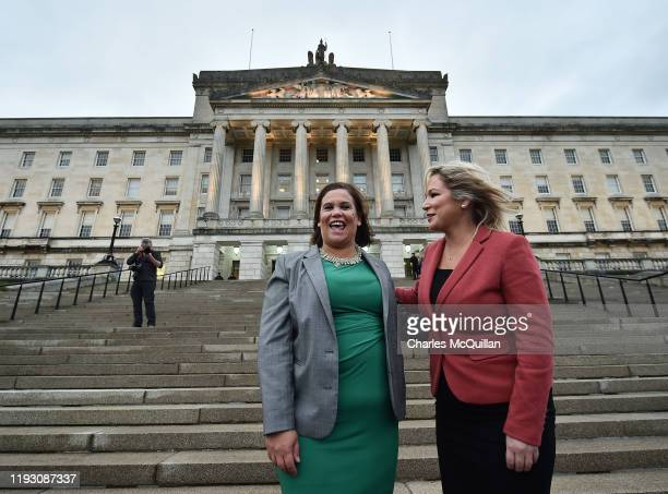 Sinn Fein President Mary Lou McDonald and Deputy First Minister Michelle O'Neill pose outside Stormont after the power sharing executive was returned...