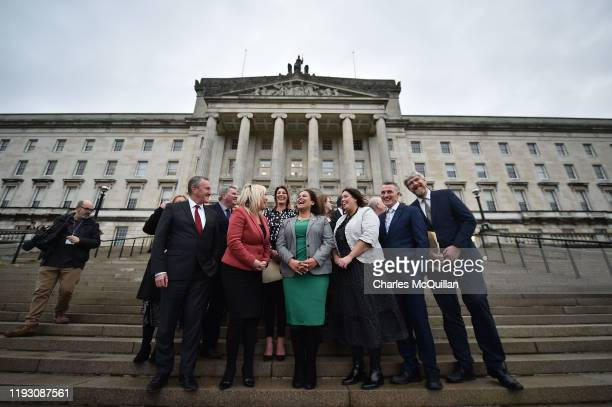 Sinn Fein President Mary Lou McDonald and Deputy First Minister Michelle O'Neill pose outside Stormont with the rest of their Sinn Fein ministers and...