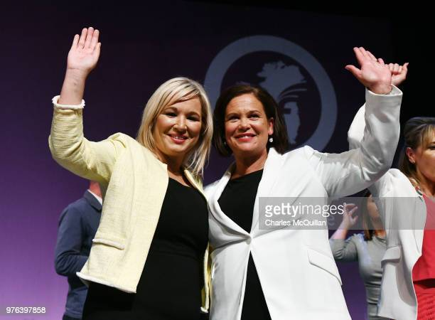 Sinn Fein president Mary Lou McDonald and vice president Michelle O'Neill wave to the crowd after McDonald's keynote speech during the Sinn Fein Ard...