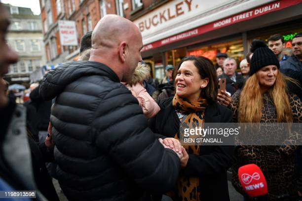 Sinn Fein President Mary Lou McDonald greets a local man as she canvasses for support in Dublin on February 6 ahead of the February 8 General...