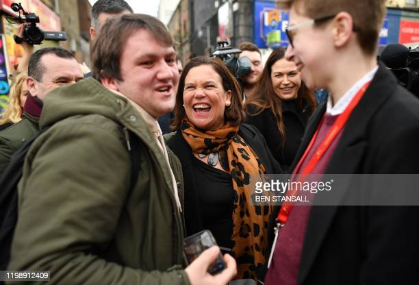 Sinn Fein President Mary Lou McDonald reacts as she canvasses for support in Dublin on February 6 ahead of the February 8 General Election Ireland...