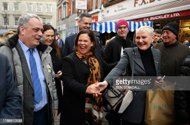 Sinn Fein President Mary Lou McDonald reacts as she canvasses members of the public for support in Dublin on February 6 ahead of the February 8...