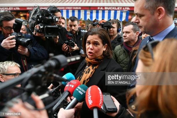 Sinn Fein President Mary Lou McDonald speaks to members of the media as she canvasses for support in Dublin on February 6 ahead of the February 8...