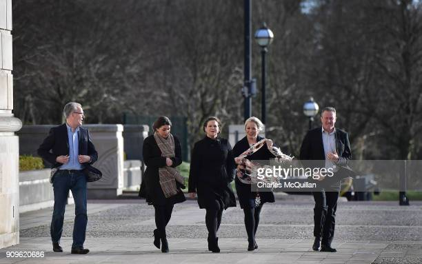 Sinn Fein presidentelect Mary Lou McDonald arrives at Stormont as northern leader Michelle O'Neill's scarf is blown by the wind on January 24 2018 in...