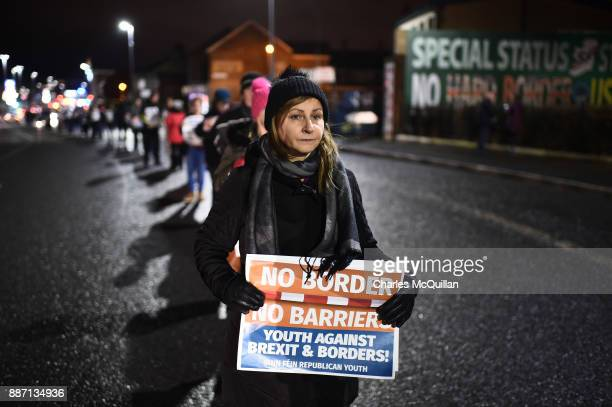 Sinn Fein protestors hold an antiBrexit white line rally on December 6 2017 in Belfast Northern Ireland Brexit negotiations broke down earlier this...
