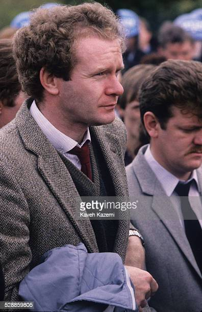 Sinn Fein's deputy leader and alleged IRA chief of staff Martin McGuinness attends the funeral of an IRA volunteer as officers of the Garda look on...