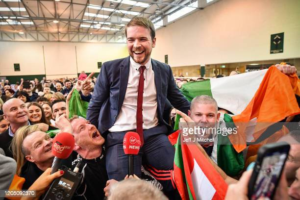 Sinn Fein's Donnchadh Ó Laoghaire celebrates being the first TD elected to the 33rd Dáil, topping the poll ahead of Micheál Martin, Simon Coveney and...