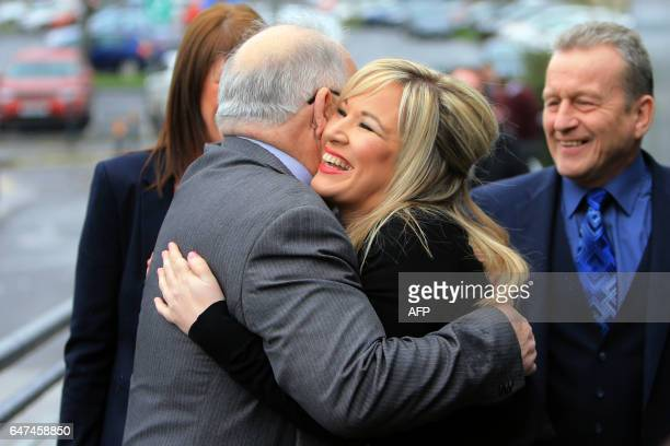 Sinn Fein's Michelle O'Neill is greeted by party colleague Francie Molloy as they arrive at the MidUlster count for the Northern Ireland Assemby...