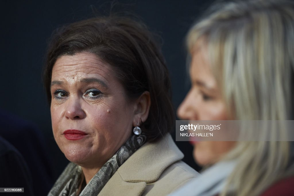 Sinn Féin President Mary Lou McDonald, (L), accompanied by Sinn Féin Vice-President Michelle O'Neill, speaks to the media outside the Houses of Parliament in central London, on February 21, 2018. Britain's Prime Minister Theresa May is to meet the leaders of the DUP and Sinn Fein at Westminster on February 21, 2018, in a bid to kickstart progress on restoring powersharing. / AFP PHOTO / NIKLAS HALLE'N