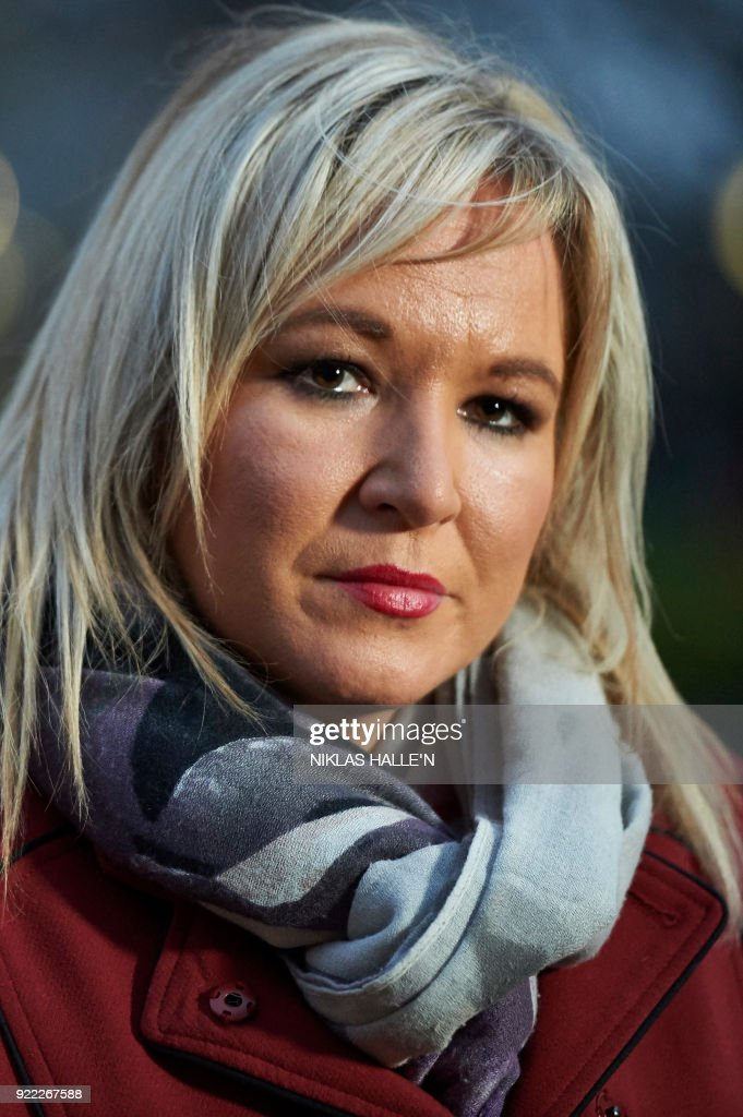 Sinn Féin Vice-President Michelle O'Neill speaks to the media outside the Houses of Parliament in central London, on February 21, 2018. Britain's Prime Minister Theresa May is to meet the leaders of the DUP and Sinn Fein at Westminster on February 21, 2018, in a bid to kickstart progress on restoring powersharing. / AFP PHOTO / NIKLAS HALLE'N