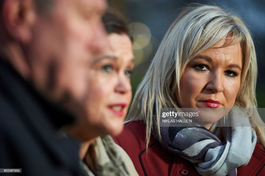 Sinn Féin's conor Murphy MLA, (L), Sinn Féin President Mary Lou McDonald, (C), and Sinn Féin Vice-President Michelle O'Neill face the media outside the Houses of Parliament in central London, on February 21, 2018. Britain's Prime Minister Theresa May is to meet the leaders of the DUP and Sinn Fein at Westminster on February 21, 2018, in a bid to kickstart progress on restoring powersharing. / AFP PHOTO / NIKLAS HALLE'N