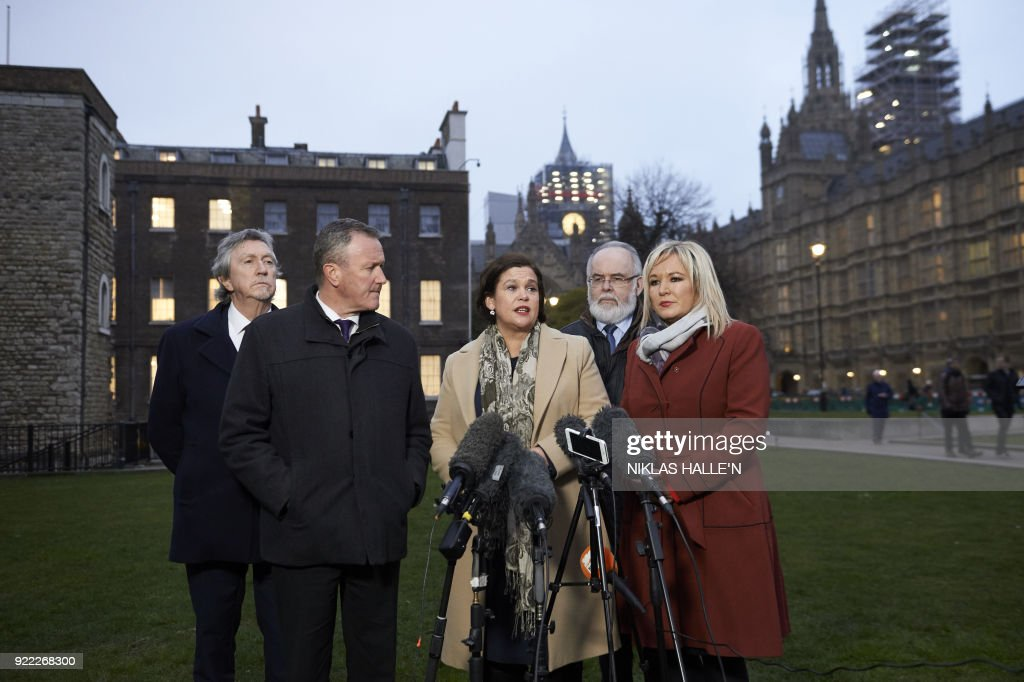 Sinn Féin's conor Murphy MLA, (2L), Sinn Féin President Mary Lou McDonald, (C), Sinn Féin's Francie Molloy MP (2R) and Sinn Féin Vice-President Michelle O'Neill (R) face the media outside the Houses of Parliament in central London, on February 21, 2018. Britain's Prime Minister Theresa May is to meet the leaders of the DUP and Sinn Fein at Westminster on February 21, 2018, in a bid to kickstart progress on restoring powersharing. / AFP PHOTO / NIKLAS HALLE'N