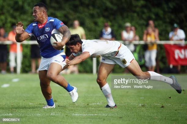 Sinoti Sinoti of Samoa eludes Christopher Hilsenbeck of Germany during the Germany v Samoa Rugby World Cup 2019 qualifying match on July 14 2018 in...
