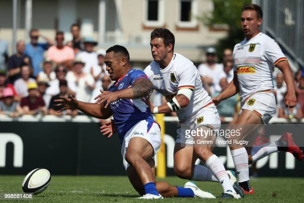 Sinoti Sinoti of Samoa is challenged by Raynor Parkinson of Germany during the Germany v Samoa Rugby World Cup 2019 qualifying match on July 14 2018...