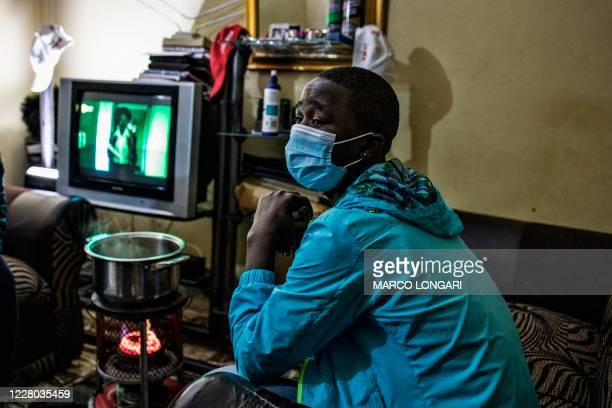 """Sinoyolo who is waiting to undergo male initiation, a cultural practice known as """"Ukwaluko"""" that marks a boy's transition into adulthood, poses for a..."""
