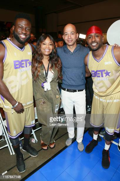 Sinqua Walls EVP Head of Programming BET Networks Connie Orlando BET Networks President Scott M Mills and Jackie Long attend the BETX Celebrity...