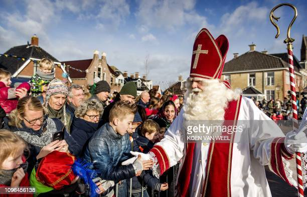 Sint Piter meets children as he arrives with Swarte Pyt in the village of Grouw The Netherlands on February 9 2019 In the Netherlands the annual...