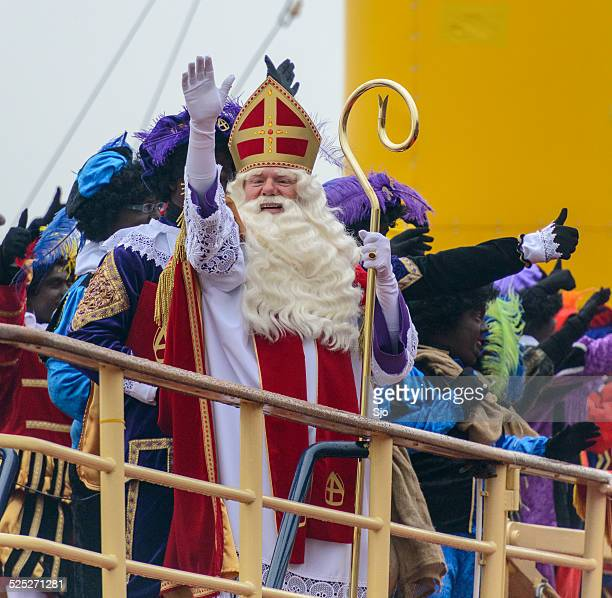 sinterklaas and zwarte pieten on the steamboat - vintage steamship stock photos and pictures