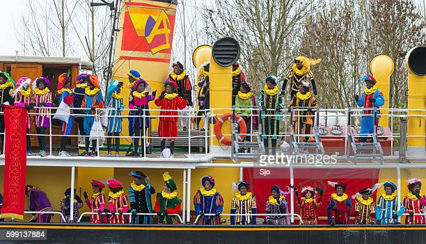 sinterklaas arriving in the netherlands - vintage steamship stock photos and pictures