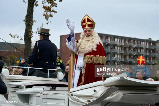 Sinterklaas parades in a horsedrawn carriage during the celebration of his arrival in Apeldoorn on November 16 2019 in Apeldoorn Netherlands Between...