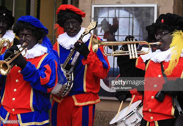 """Sinterklaas, the Dutch version of Santa Claus and his """"Zwarte Piet"""", or Black Pete with blackface arrival at Dam squarer on November 17, 2013 in..."""