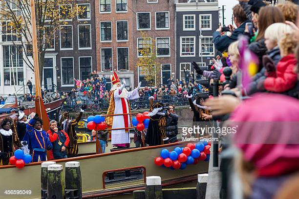 Sinterklaas waving at spectators on bridge