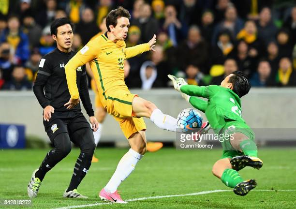 Sinthaweechai Hathairattanakool of Thailand makes a save as Robbie Kruse of Australia goes for goal during the 2018 FIFA World Cup Qualifier match...