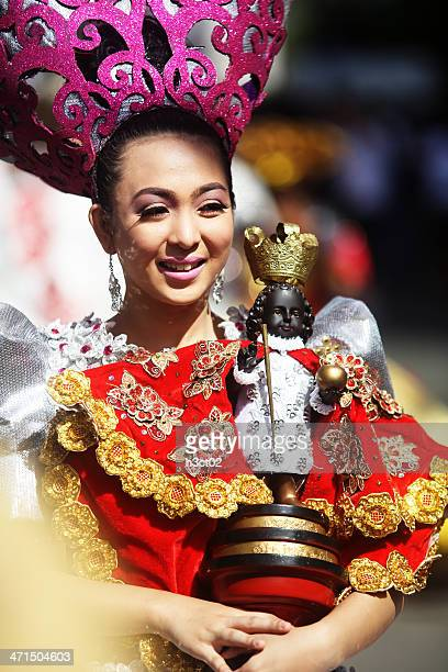 sinulog dancer with santo niño - sinulog festival stock photos and pictures