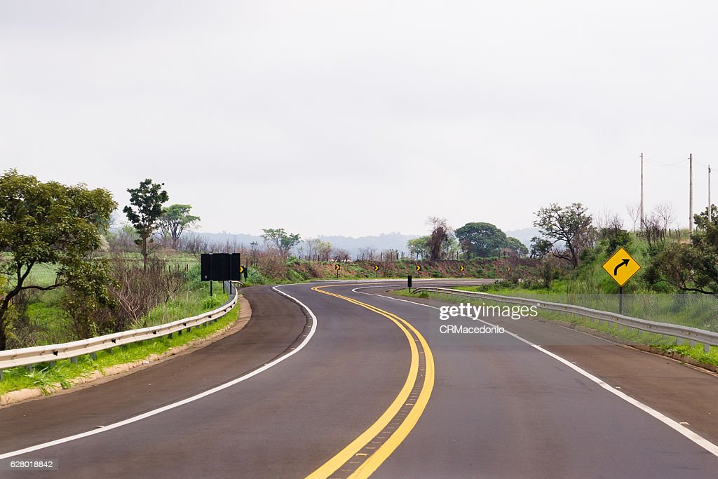 Sinuous and well signposted highway. : Stock Photo