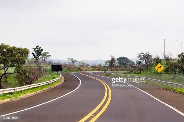 sinuous and well signposted highway. - crmacedonio stockfoto's en -beelden