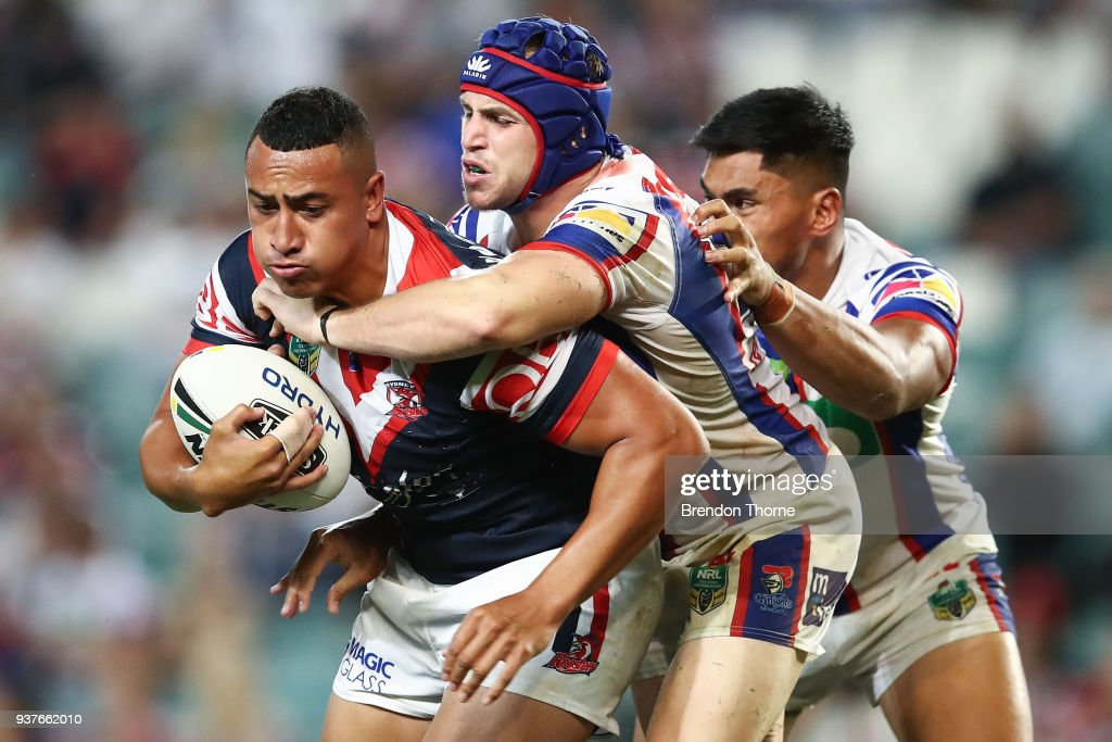 Sio Sau Taukeiaho of the Roosters is tackled by the Knights defence during the round three NRL match between the Sydney Roosters and the Newcastle Knights at Allianz Stadium on March 25, 2018 in Sydney, Australia.