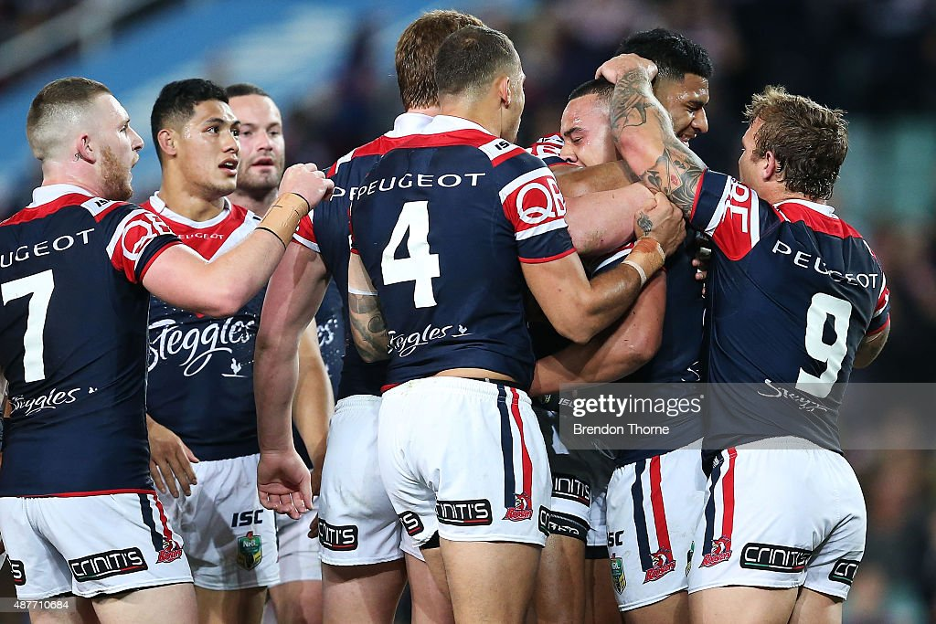 Sio Siua Taukeiaho of the Roosters celebrates with team mates after scoring a try during the NRL qualifying final match between the Sydney Roosters and the Melbourne Storm at Allianz Stadium on September 11, 2015 in Sydney, Australia.