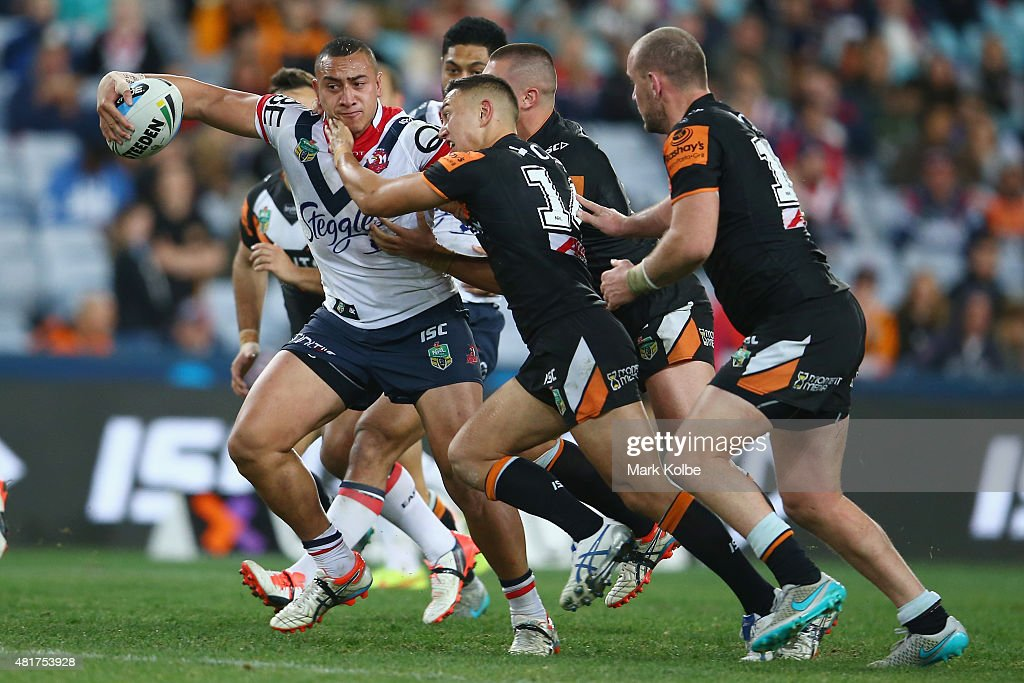 Sio Siua Taukeiaho of the Roosters is tackled during the round 20 NRL match between the Wests Tigers and the Sydney Roosters at ANZ Stadium on July 24, 2015 in Sydney, Australia.