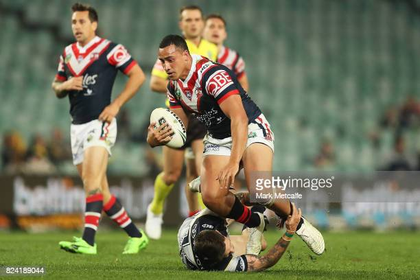 Sio Siua Taukeiaho of the Roosters is tackled during the round 21 NRL match between the Sydney Roosters and the North Queensland Cowboys at Allianz...