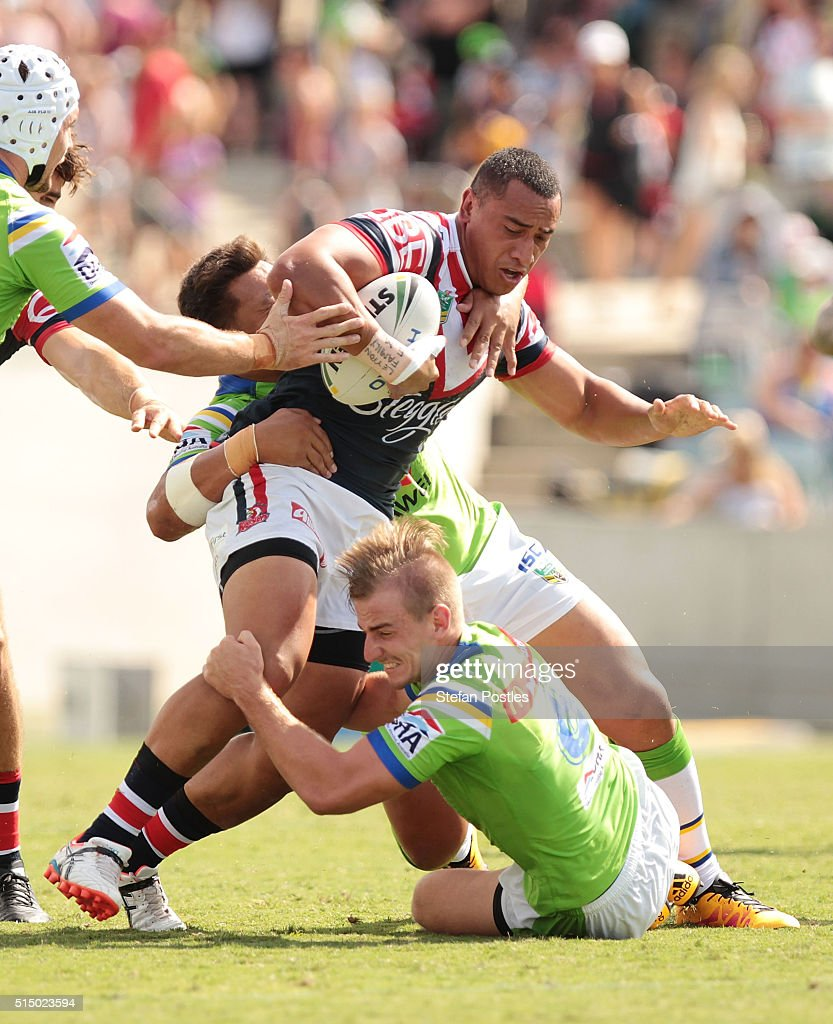 Sio Siua Taukeiaho of the Roosters is tackled during the round two NRL match between the Canberra Raiders and the Sydney Roosters at GIO Stadium on March 12, 2016 in Canberra, Australia.