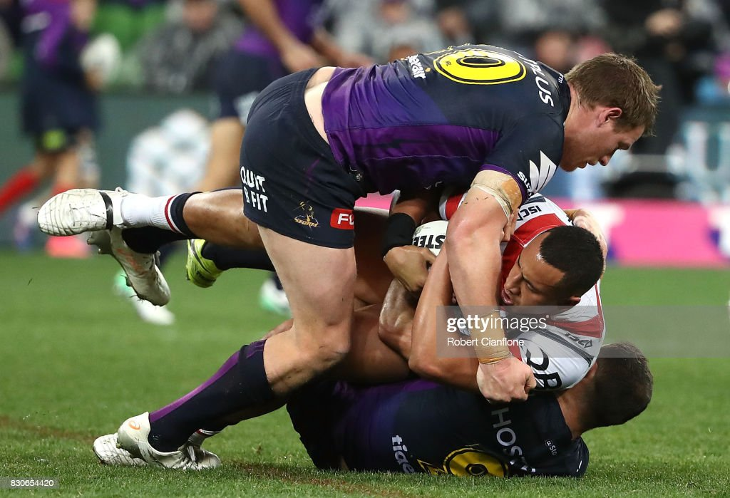 Sio Siua Taukeiaho of the Roosters Tim Glasby and Cameron Smith of the Storm during the round 23 NRL match between the Melbourne Storm and the Sydney Roosters at AAMI Park on August 12, 2017 in Melbourne, Australia.