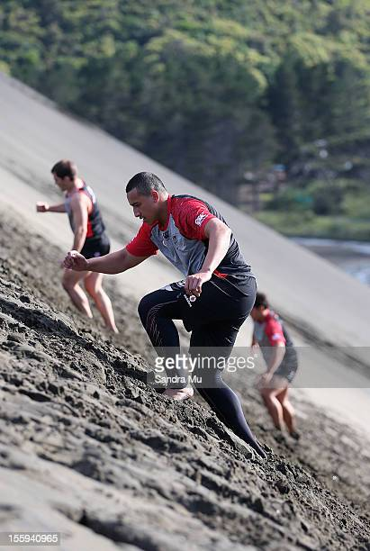 Sio Siua Taukeiaho of the Warriors trains on the sand dunes during the New Zealand Warriors NRL training session at Bethells Beach on November 10...