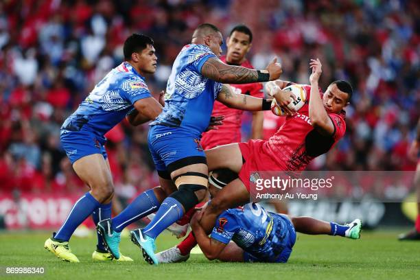 Sio Siua Taukeiaho of Tonga is tackled by Junior Paulo of Samoa during the 2017 Rugby League World Cup match between Samoa and Tonga at Waikato...