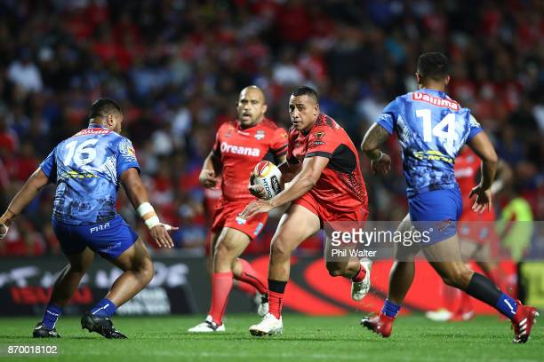 Sio Siua Taukeiaho of Tonga is tackled during the 2017 Rugby League World Cup match between Samoa and Tonga at Waikato Stadium on November 4 2017 in...