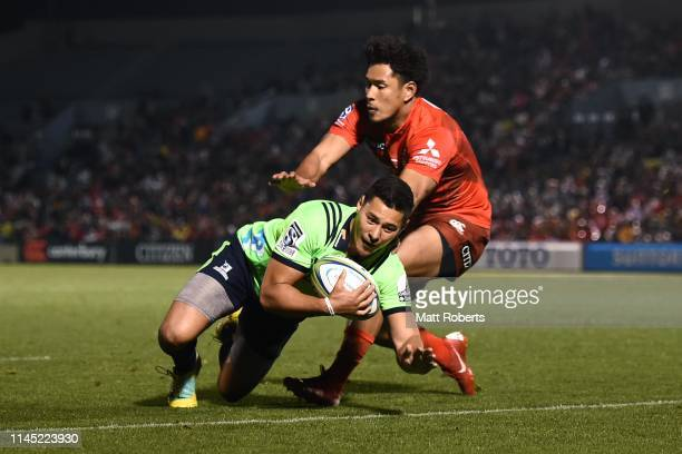Sio Tomkinson of the Highlanders dives to score his side' eighth try during the round 11 Super Rugby match between Sunwolves and Highlanders at the...