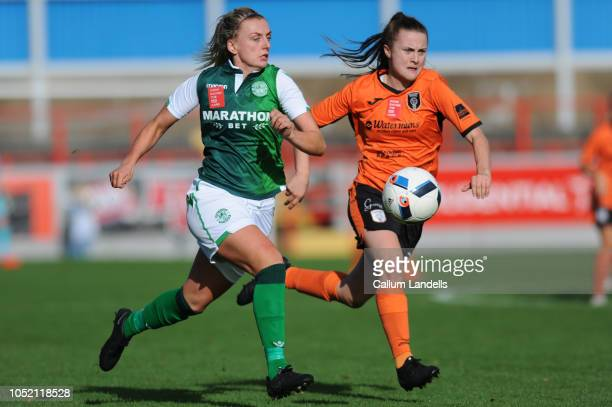 Siobhan Hunter of Hibernian FC and Kirsty Howat of Glasgow City FC go up against each other during the SSE Scottish Women's Cup semi final at the...