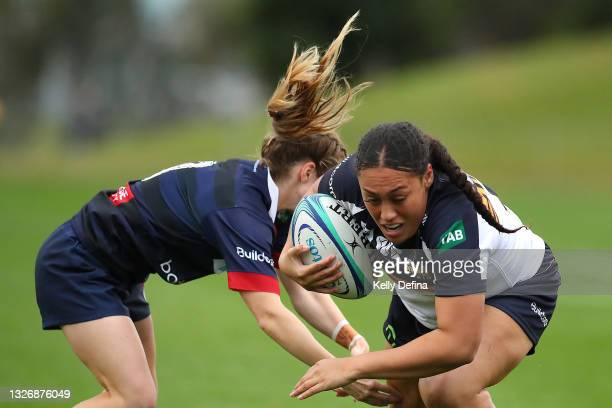 Siokapesi Palu of the Brumbies is tackled by Georgia Cormick of the Rebels during the Super W match between the Melbourne Rebels and the ACT Brumbies...